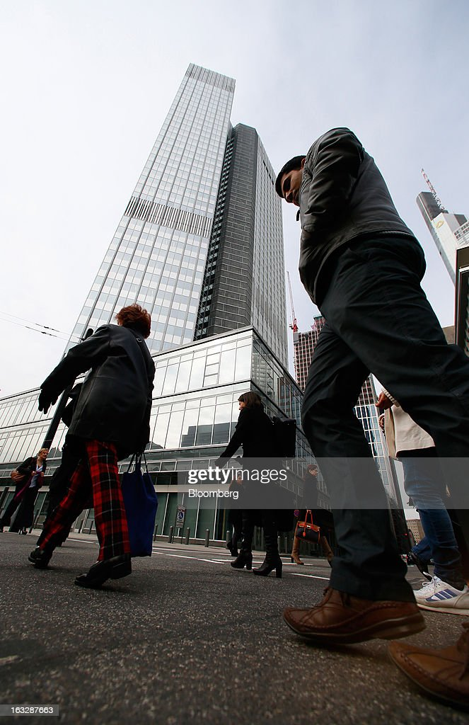 Pedestrians pass the headquarters of the European Central Bank (ECB) in Frankfurt, Germany, on Thursday, Mar. 7, 2012. The European Central Bank left interest rates on hold as it gauges how big a threat Italy poses to the economic recovery. Photographer: Ralph Orlowski/Bloomberg via Getty Images