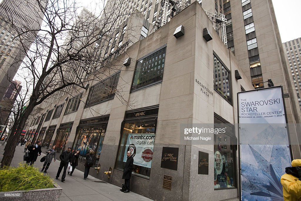 Pedestrians pass the NBC Experience Store at Rockefeller Center on December 1, 2009 in New York City. General Electric is poised to buy Vivendi's NBC Universal stake.