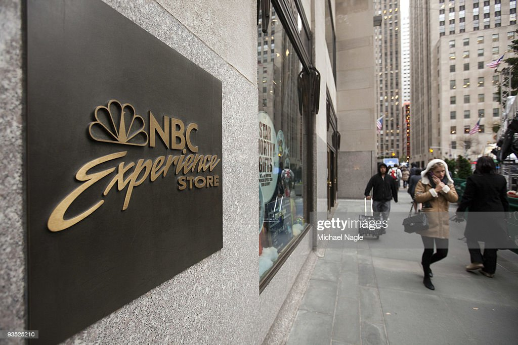 Pedestrians pass the NBC Experience Store at Rockefeller Cetner on December 1, 2009 in New York City. General Electric is poised to buy Vivendi's NBC Universal stake.
