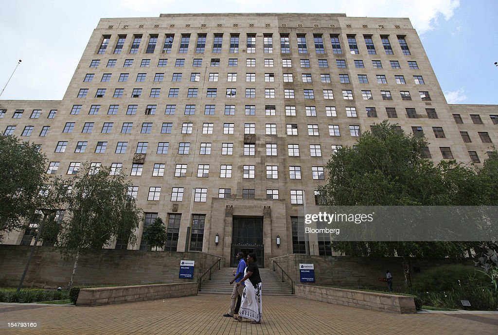 Pedestrians pass the offices of Anglo American Plc in the Marshalltown district of Johannesburg, South Africa, on Friday, Oct. 26, 2012. Anglo American Plc Chief Executive Officer Cynthia Carroll , the first woman, external hire and non-South African to hold the job, will quit after Anglo lost $14 billion in value in the more than five years she was in charge. Photographer: Chris Ratcliffe/Bloomberg via Getty Images