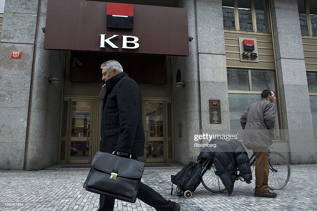 Pedestrians pass the offices of the Komercni Banka AS bank in the financial district of Prague, Czech Republic, on Tuesday, Jan. 8, 2013. The Czech economy is showing weak domestic demand as households and businesses cut spending due to government austerity programs and the euro area's debt crisis. Photographer: Bartek Sadowski/Bloomberg via Getty Images