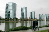 Pedestrians pass the Oracle Corp headquarters March 20 2006 in Redwood City California Oracle Corps quarterly profit increased 42 percent earning...