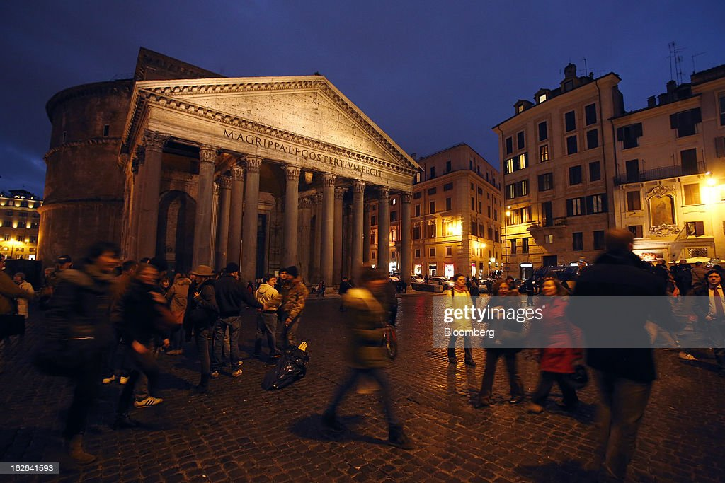 Pedestrians pass the Pantheon at night in Rome, Italy, on Friday, Feb. 22, 2013. Italy's borrowing costs rose at an auction of zero-coupon bonds today as investors await the outcome of an election that may produce a fragmented parliament. Photographer: Alessia Pierdomenico/Bloomberg via Getty Images