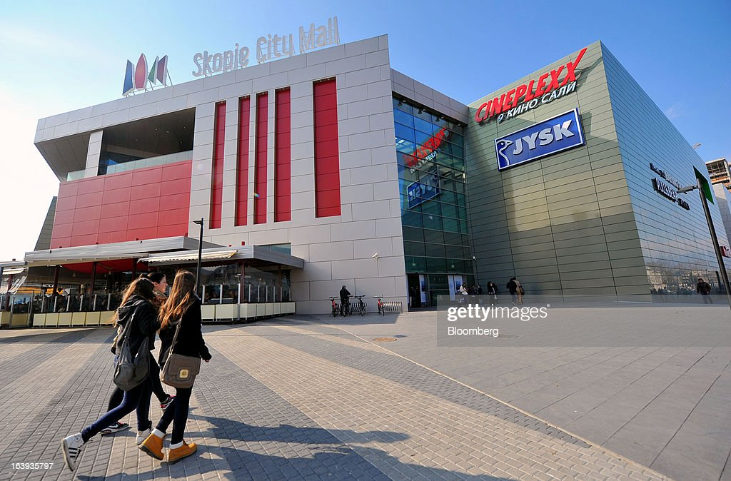 Pedestrians pass the Skopje City Mall shopping center in central Skopje, Macedonia, on Saturday, March 16, 2013. Macedonia's economy contracted by a real 0.3% on the year in 2012, compared to a growth of 2.8% a year earlier, an estimate released by the country's statistics office showed. Photographer: Oliver Bunic/Bloomberg via Getty Images