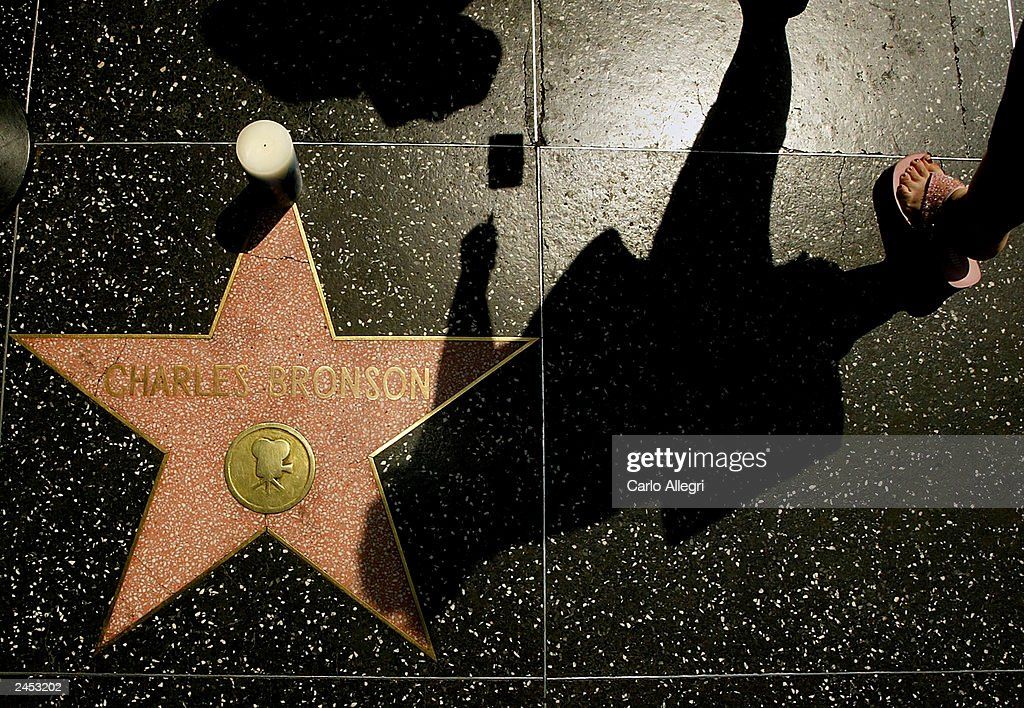 Pedestrians pass the star of actor Charles Bronson on the Hollywood Walk of Fame September 1, 2003 in Hollywood, California. Bronson died of pneumonia at the age of 81 August 30, 2003 in Los Angeles, California.