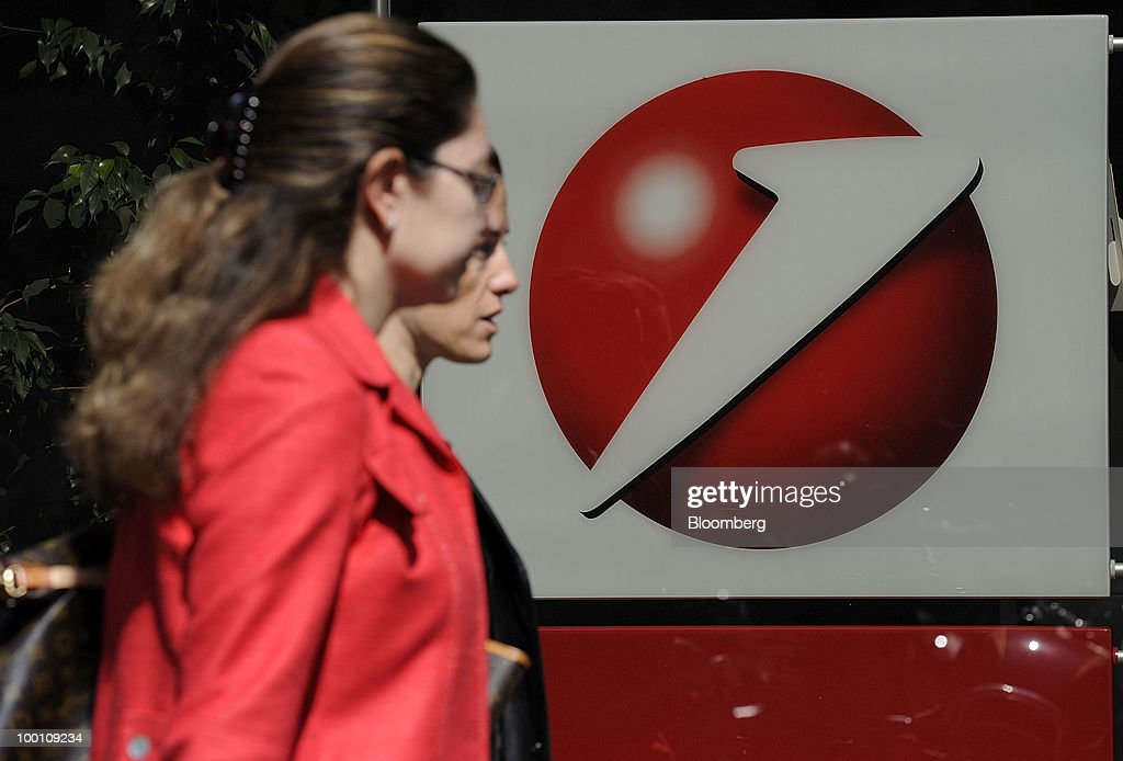 Pedestrians pass the UniCredit SpA logo at the bank's headquarters in Milan, Italy, on Friday, May 21, 2010. UniCredit SpA Chief Executive Officer Alessandro Profumo said that contagion from Greece's debt crisis will be managed and that Europe should concentrate on growth and not just cutting public debt. Photographer: Giuseppe Aresu/Bloomberg via Getty Images