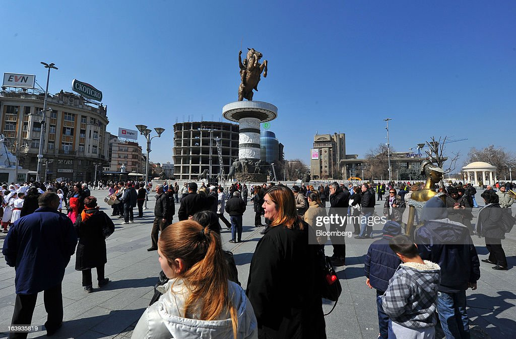 Pedestrians pass through a main square past a monument to Alexander the Great in central Skopje, Macedonia, on Sunday, March 17, 2013. Macedonia's economy contracted by a real 0.3% on the year in 2012, compared to a growth of 2.8% a year earlier, an estimate released by the country's statistics office showed. Photographer: Oliver Bunic/Bloomberg via Getty Images