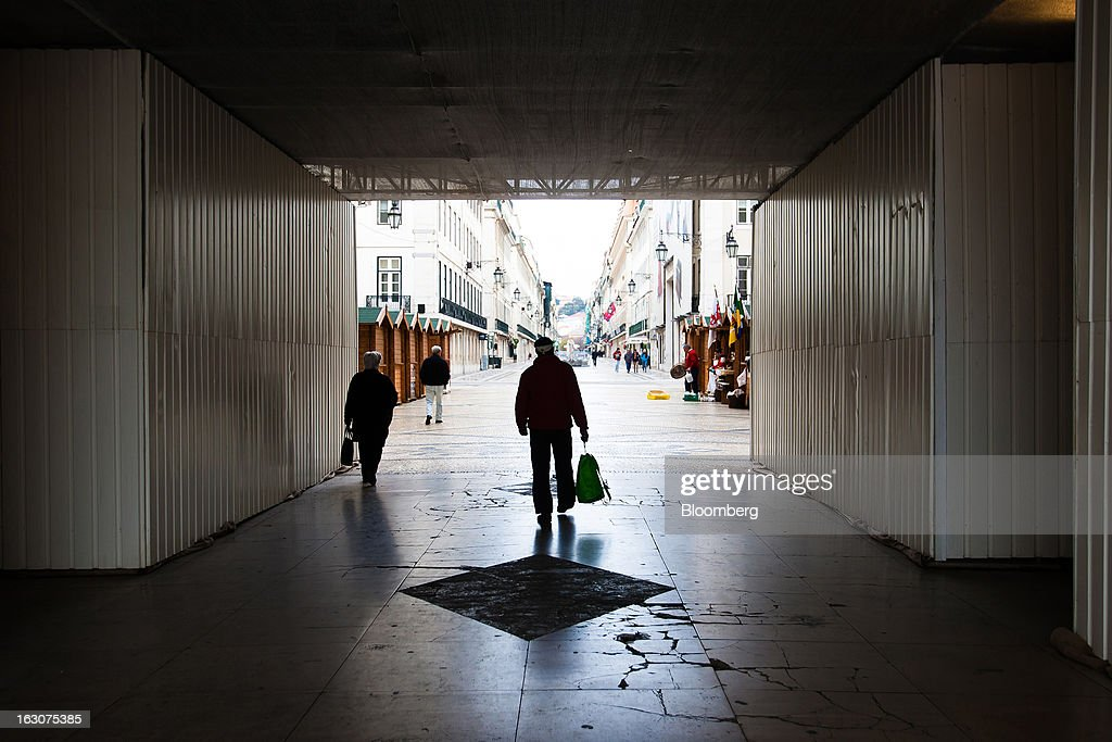 Pedestrians pass through a subway on a shopping street in Lisbon, Portugal, on Saturday, March 2, 2013. Prime Minister Pedro Passos Coelho is battling rising joblessness and lower demand from European trading partners as he raises taxes to meet the terms of a 78 billion-euro ($104 billion) aid plan from the European Union and the International Monetary Fund. Photographer: Mario Proenca/Bloomberg via Getty Images