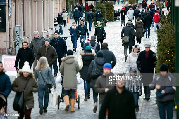Pedestrians pass through Drottninggatan one of the main shopping streets in Malmoe Sweden on Friday Jan 6 2011 Swedish data indicate the largest...