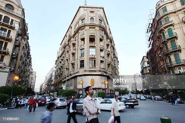Pedestrians pass through Talat Harb square in downtown Cairo Egypt on Thurdsay May 12 2011 An Egyptian court is set to rule this month on Hamdy El...