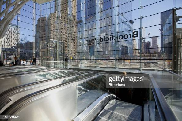 Pedestrians ride the escalator in the West Concourse at the World Trade Center site in New York US on Thursday Oct 24 2013 The 600foot long...