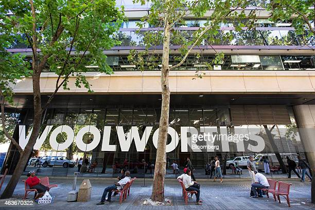 Pedestrians sit on street benches outside the headquarters of Woolworths Holdings Ltd in Cape Town South Africa on Monday Feb 16 2015 Woolworths the...