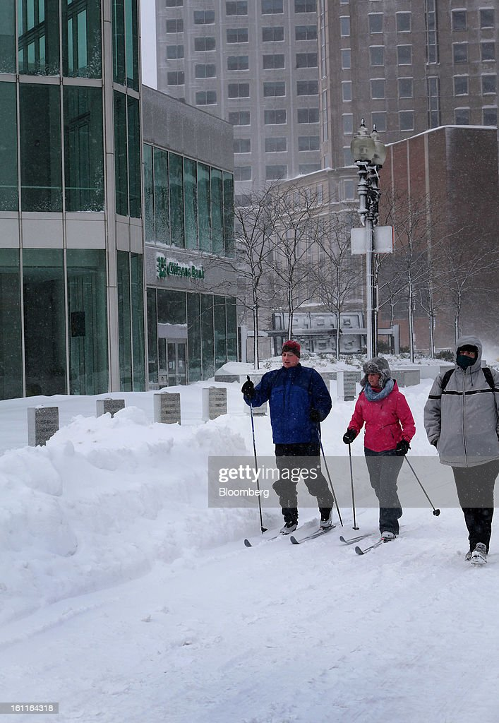 Pedestrians ski down Summer Street after Winter Storm Nemo in Boston, Massachusetts, U.S., on Saturday, Feb. 9, 2013. More than two feet of snow fell on parts of the U.S. Northeast as high winds left hundreds of thousands of people in the region without power, closed highways and forced the cancellation of 4,700 flights. Photographer: Brian Sullivan/Bloomberg via Getty Images