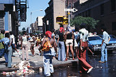 Pedestrians stand on a street corner in the wake of the New York City blackout Brooklyn New York New York July 14 1977