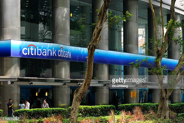 Pedestrians stand outside a Citigroup Inc Citibank branch in Singapore on Friday June 14 2013 Singapore's central bank plans to reprimand banks in...