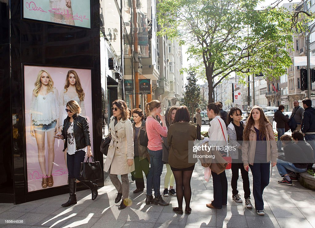 Pedestrians stand outside a Miss Selfridge fashion store in the Nisantasi district of Istanbul, Turkey, on Thursday, April 4, 2013. Turkey's gross domestic product expanded 2.2 percent in 2012, down from 8.8 percent the previous year, according to data released by the statistics office in Ankara on April 1. Photographer: Kerem Uzel/Bloomberg via Getty Images