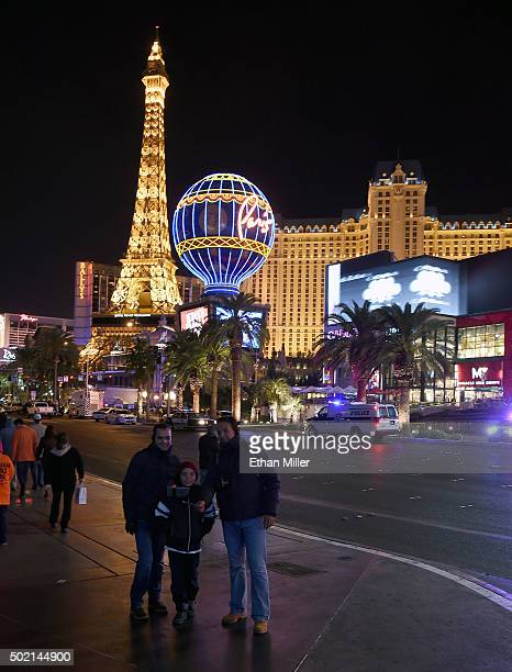 Pedestrians take a selfie across the street from the Paris Las Vegas after police shut down vehicle traffic on the Las Vegas Strip after a car...