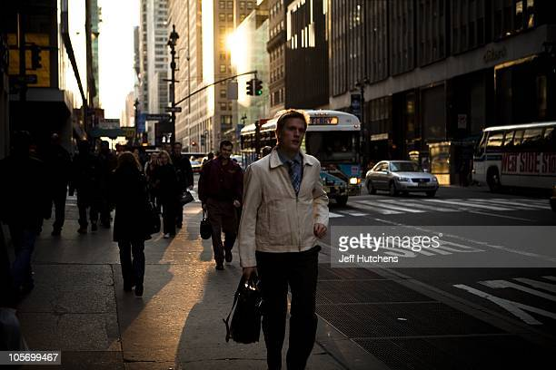 Pedestrians travel the streets during the late afternoon rush hour in Midtown Mahattan home to many of the world's banks on April 9 2009 in New York...
