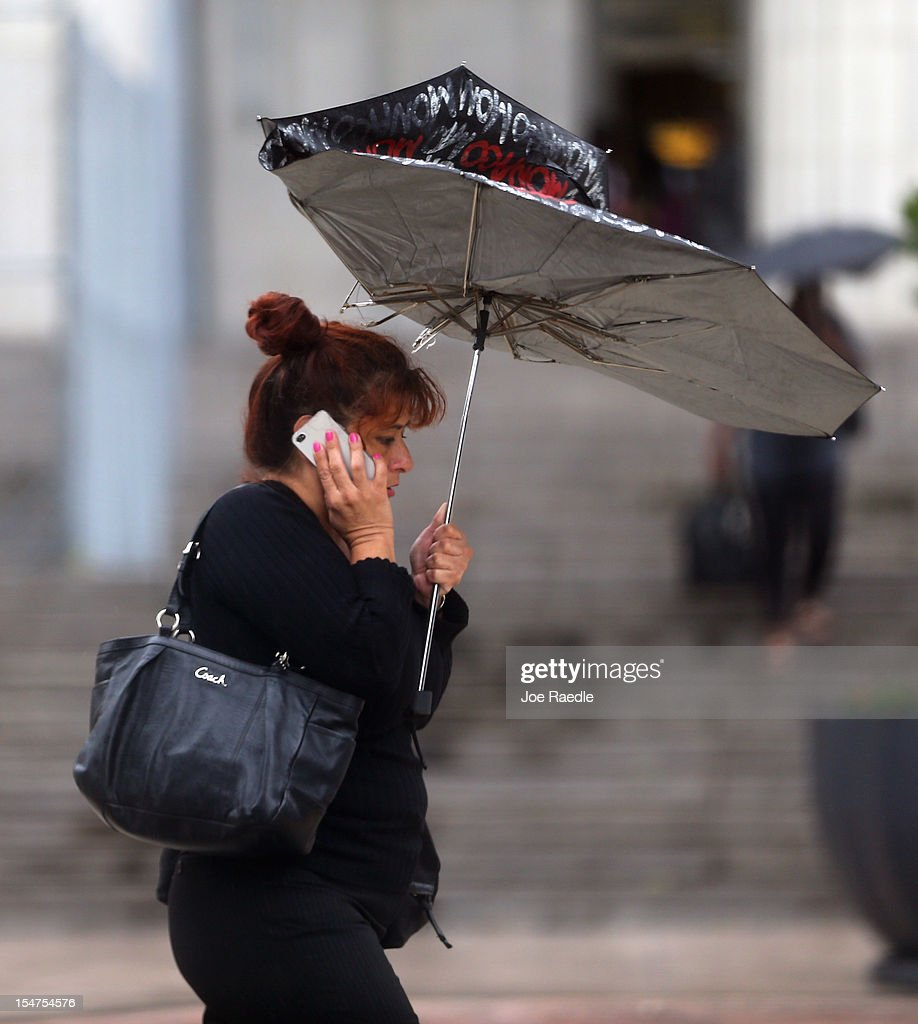 A pedestrian's umbrella is turned inside out as high winds hit it as the outer bands of Hurricane Sandy are felt on October 25, 2012 in Miami Beach, Florida. After passing over Jamaica and eastern Cuba Hurricane Sandy is expected to hit eastern Cuba and head into the Bahamas Thursday and Friday, there is a tropical storm warning in place for coastal Miami-Dade, Broward, and Palm Beach Counties and the Atlantic waters off southeast Florida.