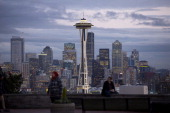 Pedestrians visit Kerry Park as the Space Needle and buildings stand in the downtown skyline of Seattle Washington US on Tuesday Nov 12 2013 The...