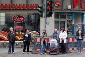 Pedestrians wait at a traffic light on April 3 2012 in DuisburgMarxloh Germany The city of Dortmund is located in the traditionally industryheavy...