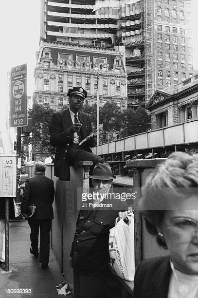 Pedestrians wait for the bus on 5th Avenue and 42nd Street New York City 1984