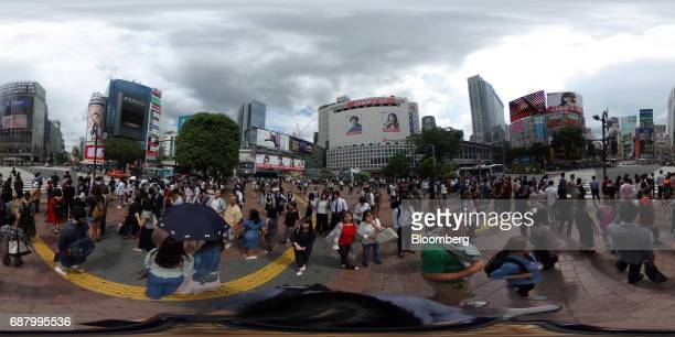 Pedestrians wait to cross a road in the Shibuya area of Tokyo Japan on Wednesday May 24 2017 Japan is scheduled to release Consumer Price Index...