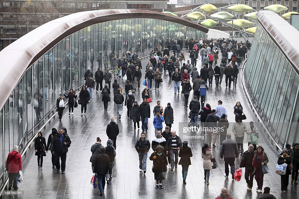 Pedestrians walk across a bridge connecting the Westfield Stratford City shopping mall and Stratford mainline railway station in London, U.K., on Thursday, Dec. 27, 2012. Overall Christmas shopping in the U.K. was similar to last year, according to the British Retail Consortium. Photographer: Chris Ratcliffe/Bloomberg via Getty Images