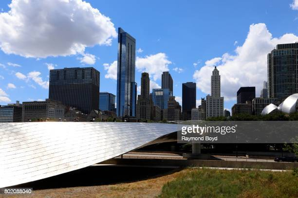 Pedestrians walk across Frank Gehry's 'BP Pedestrian Bridge' over to Millennium Park in Chicago Illinois on June 24 2017