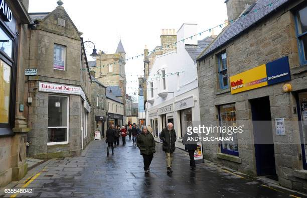 Pedestrians walk along a shopping street in Lerwick Shetland Islands on February 4 2017 Of all the ramifications of the Brexit vote the fate of the...
