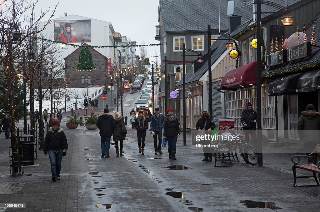 Pedestrians walk along a shopping street in Reykjavik, Iceland, on Wednesday, Jan. 2, 2013. Creditors of Iceland's three biggest failed banks are fighting for a waiver to krona controls imposed in 2008 amid risks pay-outs will be delayed beyond 2015. Photographer: Arnaldur Halldorsson/Bloomberg via Getty Images