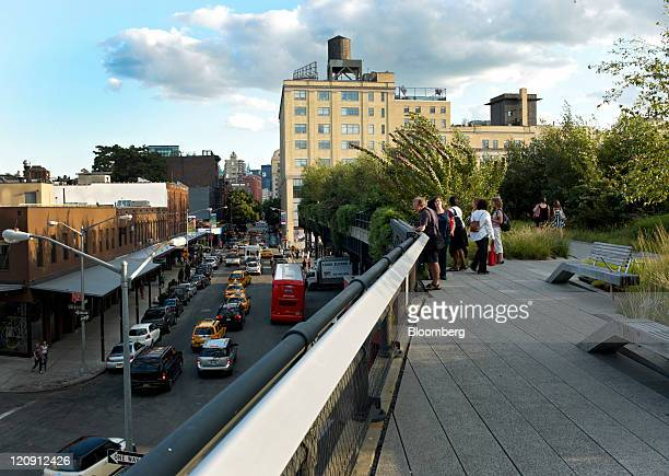 Pedestrians walk along the High Line in the Meatpacking District of New York US on Thursday Aug 11 2011 Stores such as Kalinsky's Jeffrey New York...