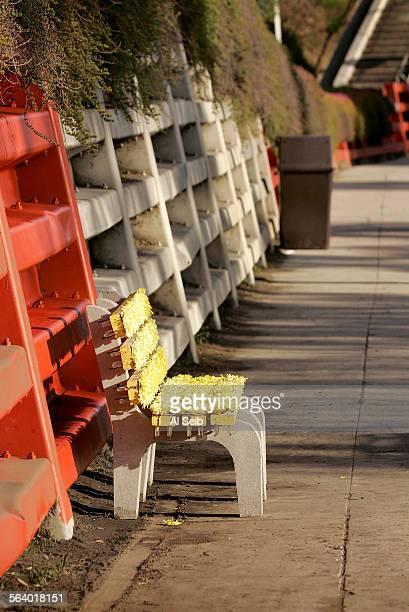 LOS ANGELES CA Pedestrians walk and motorist drive past the flower–adorned park bench artwork located on Glendale Blvd in Echo Park Artist Justin...
