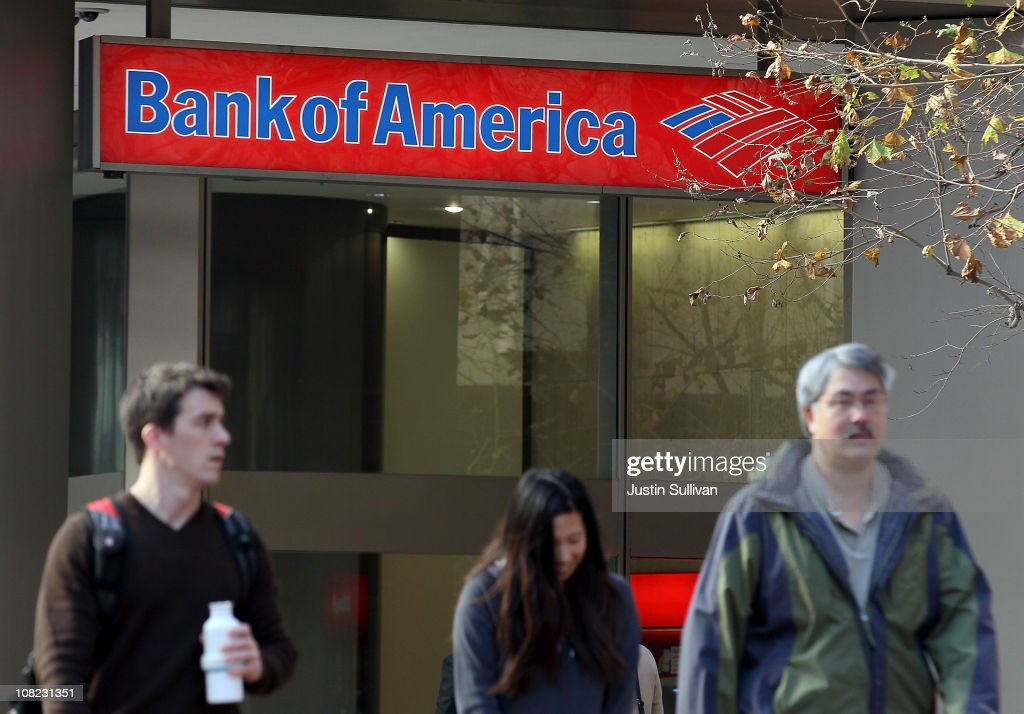 Pedestrians walk by a Bank of America branch office on January 21, 2011 in San Francisco, California. Bank of America reported a fourth quarter loss of $1.2 billion, or 16 cents a share, bringing total losses for the year to $2.23 billion, or 37 cents a share.