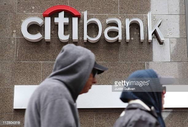 Pedestrians walk by a CitiBank branch office on April 18 2011 in San Francisco California Citigroup firstquarter profit dropped 32 percent with...