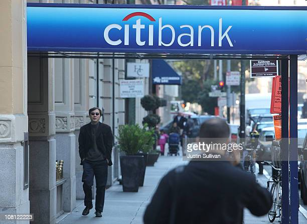 Pedestrians walk by a Citibank branch office on January 18 2011 in San Francisco California Citigroup announced its first profitable year since the...