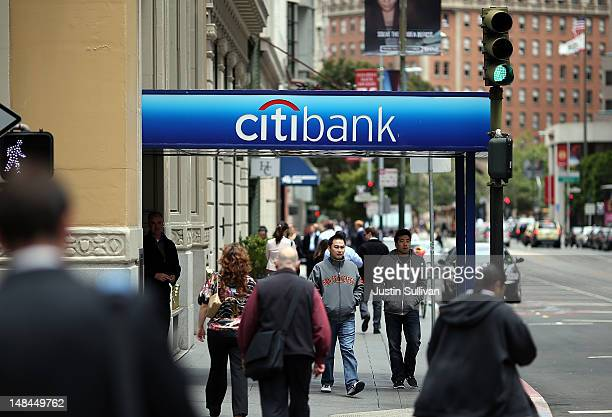 Pedestrians walk by a Citibank branch office on July 16 2012 in San Francisco California Citigroup announced a decline in quarterly earnings of 12...
