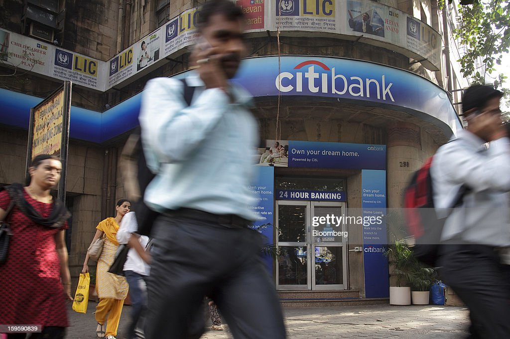 Pedestrians walk by a Citigroup Inc. bank branch in Mumbai, India, on Wednesday, Jan. 16, 2013. India's financial system has been made vulnerable by a deterioration in bank assets and a lack of capital as the economy slowed, according to the International Monetary Fund. Photographer: Kuni Takahashi/Bloomberg via Getty Images