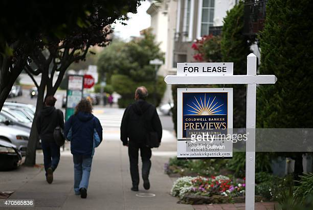 Pedestrians walk by a for lease sign on April 21 2015 in San Francisco California According to a report by Forbes magazine San Francisco Oakland and...