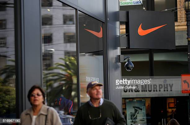 Pedestrians walk by a Nike store on March 22 2016 in San Francisco California Nike Inc will announce thirdquarter earnings after the closing bell