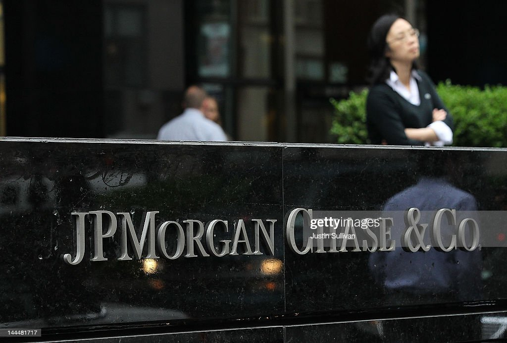 Pedestrians walk by a sign outside of a JPMorgan Chase office on May 14, 2012 in New York City. Following a $2 billion trading blunder, JPMorgan Chase's chief investment officer Ina Drew retired and will be succeeded by Matt Zames, an executive from JPMorgan's investment bank. At least two others are also being held accountable for the mistake.