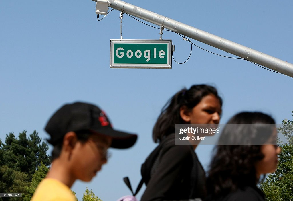 Pedestrians walk by a sign outside of the Google headquarters July 17, 2008 in Mountain View, California. Google Inc. is expected to announce an increase in quarterly profits when it reports its quarterly earnings today after the closing bell.