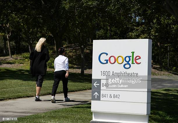 Pedestrians walk by a sign outside of the Google headquarters July 17 2008 in Mountain View California Google Inc is expected to announce an increase...
