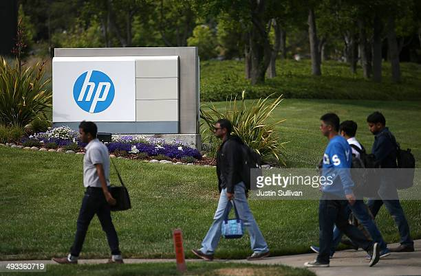 Pedestrians walk by a sign outside of the HewlettPackard headquarters on May 23 2014 in Palo Alto California HP announced on Thursday that it plans...