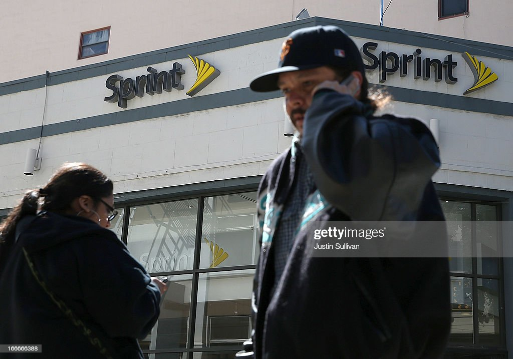 Pedestrians walk by a Sprint store on April 15, 2013 in San Francisco, California. Dish Network Corp has offered to purchase Sprint Nextel Corp for $25.5 billion in cash and stock.