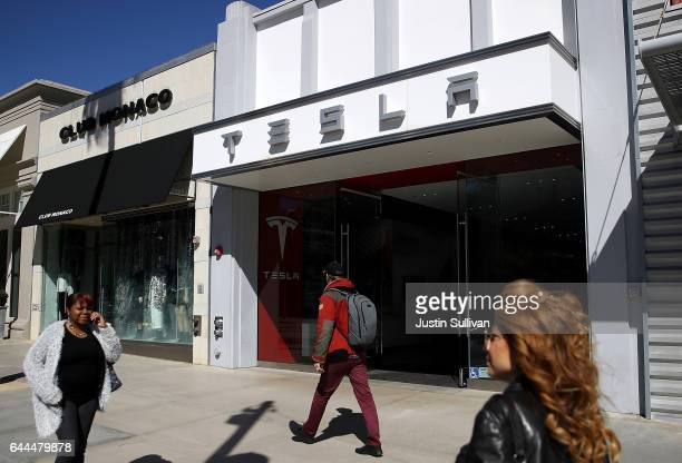 Pedestrians walk by a Tesla showroom on February 23 2017 in Santa Monica California Tesla shares dropped over 5 percent on Thursday after a mixed...