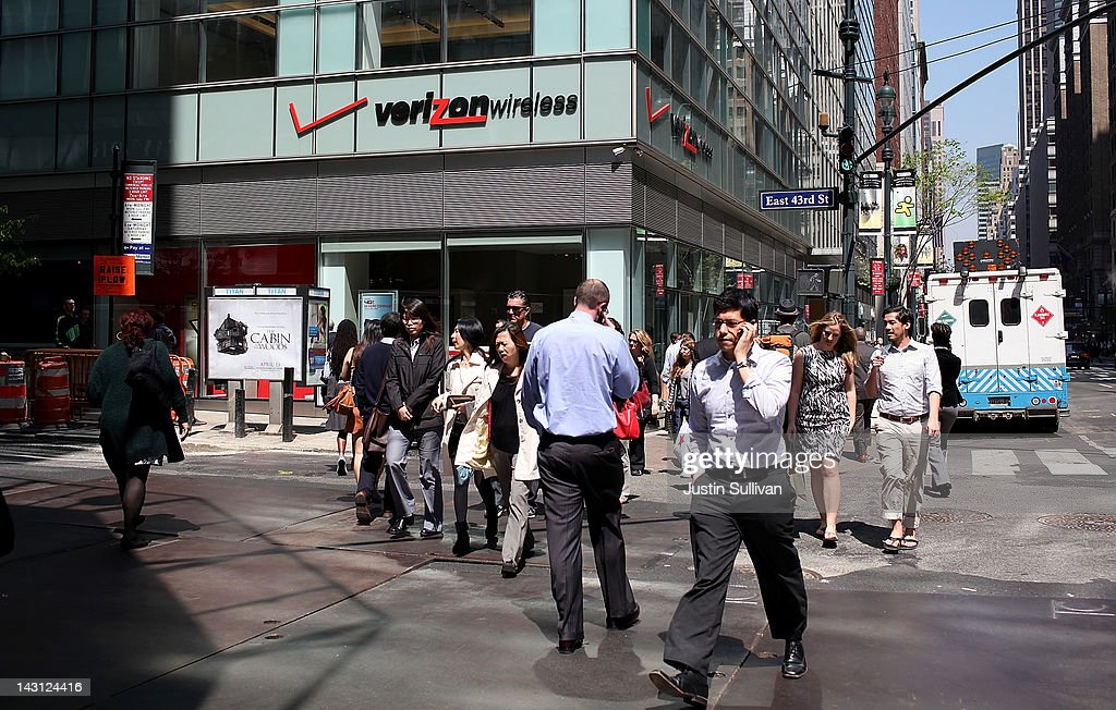 Pedestrians walk by a Verizon Wireless store on April 19, 2012 in New York City. With strong holiday sales of the iPhone 4S and a surge in customer billing Verizon reported first quarter earnings of $1.69 billion, or 59 cents per share compared to $1.44 billion, or 51 cents per share one year ago.
