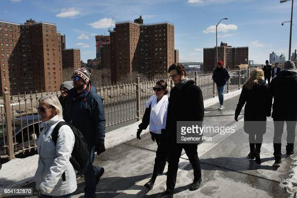 Pedestrians walk by a view of public housing in lower Manhattan on March 16 2017 in New York CityThe budget blueprint President Donald Trump released...