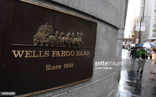 Pedestrians walk by a Wells Fargo Bank branch office January 20 2010 in San Francisco California Wells Fargo beat analyst expectations by posting a...