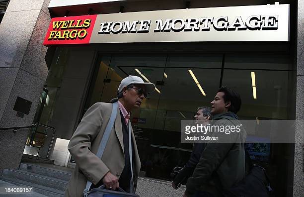 Pedestrians walk by a Wells Fargo home mortgage office on October 11 2013 in San Francisco California Wells Fargo reported a 13 percent increase in...